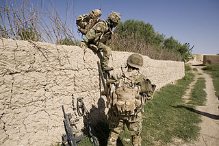 1st Bn. Royal Gurkha Rifles negotiate a wall in the Nahr-e Saraj region of Helmand province, photo ©bySgt IanForsyth, RLC CC bySA Licence